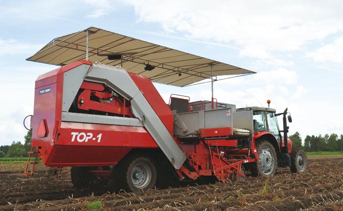 十勝野を駆けるポテトハーベスタ。東洋農機の機械の多くにはイメージカラーの赤を使用。